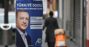 German election: Recep Tayyip Erdogan  on a poster for the Alliance of German Democrats. Photograph: Henning Kaiser/AFP/Getty