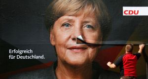 German election: a poster of Angela Merkel is pasted up in Berlin. Photograph: Fabrizio Bensch/Reuters