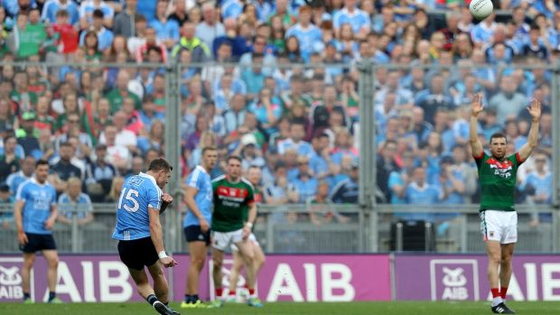 Dublin's Dean Rock kicks a free at the end of the first half. Photograph: Tommy Dickson/Inpho