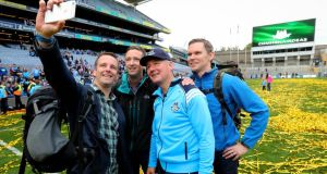 Dublin manager Jim Gavin has a selfie taken with members of the Air Corps who flew over Croke Park before the game, including Capt Sean McCarthy, Cmdt Frank Byrne and Capt Enda Walsh. Photograph: Ryan Byrne/Inpho