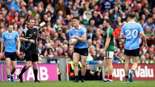 Winning point: Joe McQuillan awards Diarmuid Connolly the late free with which Dublin beat Mayo. Photograph: Ryan Byrne/Inpho