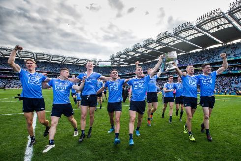 THREE-IN-A-ROW: Dublin celebrate clinching three-in-a-row by beating Mayo 1-17 to 1-16 in the All-Ireland final at Croke Park. Photograph: Tommy Dickson/Inpho