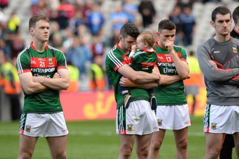 Mayo look on from left; Shane Nally, Brendan Harrison, with his child Fionn and Jason Doherty, after being beaten by Dublin, in the All Ireland senior football championship final at Croke Park, Dublin.  Photograph: Dara Mac Donaill / The Irish Times