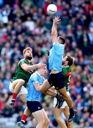 MY BALL! Mayo's Aidan O'Shea and Tom Parsons challenge Dublin's Brian Fenton and James McCarthy for a high ball. Photograph: James Crombie/Inpho