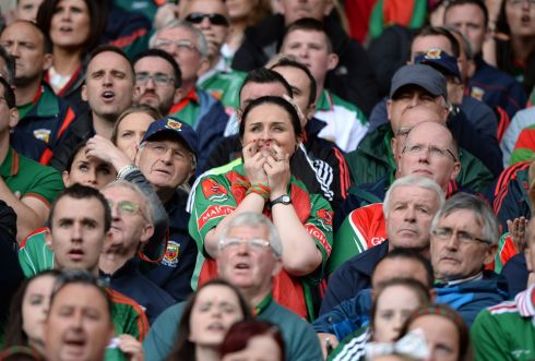 NAIL-BITING FINISH: A Mayo fan during the All Ireland football final at Croke Park. Photograph: Dara Mac Donaill/The Irish Times