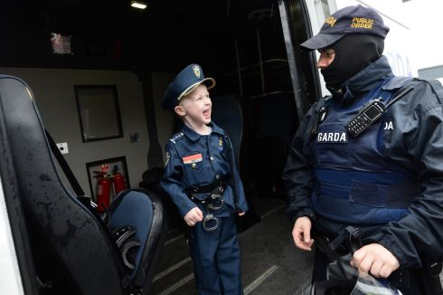 YOUNG BLOOD: Barry Deering (5), from Ashbourne, meeting Garda Seán Kelly at Blanchardstown Garda station open day, in Dublin. Photograph: Dara Mac Donaill/The Irish Times