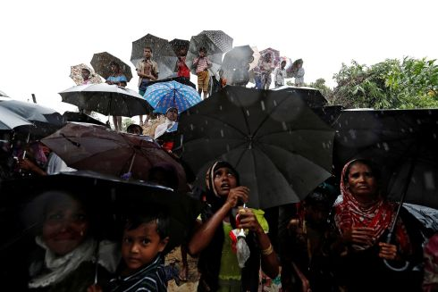 NO END IN SIGHT: Rohingya refugees wait for aid packages in the city of Cox's Bazar, Bangladesh. Photograph: Cathal McNaughton/Reuters