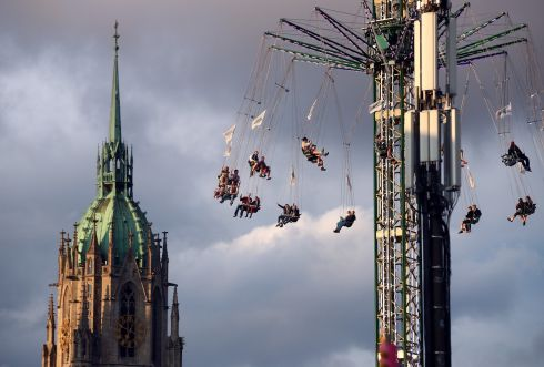 DON'T LOOK DOWN: Visitors ride a swing during the opening day of the 184th Oktoberfest in Munich, Germany. Photograph: Michael Dalder/Reuters