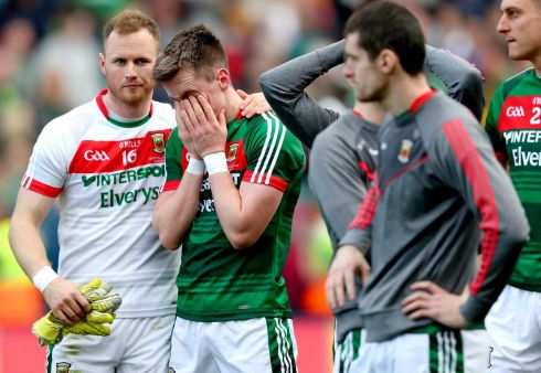 Mayo's goalkeeper Robert Hennelly consoles Cillian O?Connor Photo: INPHO/James Crombie
