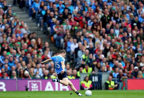 Dublin's Dean Rock kicks the winning free. Photograph: James Crombie/Inpho