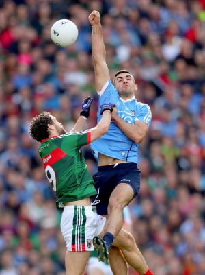 Mayo's Tom Parsons and James McCarthy of Dublin compete for high ball. Photograph: James Crombie/Inpho
