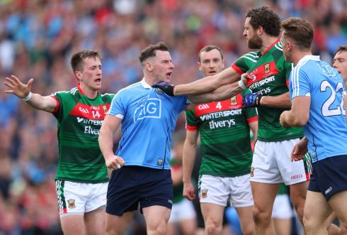 Dublin's Philly McMahon and Tom Parsons of Mayo get up close and personal. Photograph: James Crombie/Inpho