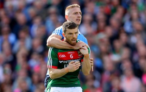 Dublin's Eoghan O'Gara gets a hold of Mayo's Chris Barrett. Photograph: James Crombie/Inpho