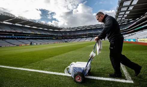 Groundsman Enda Colfer paints the lines before the game. Photograph: James Crombie/Inpho