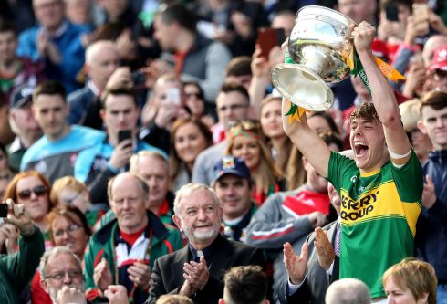 Kerry's David Clifford lifts the trophy. Photograph: Ryan Byrne/Inpho