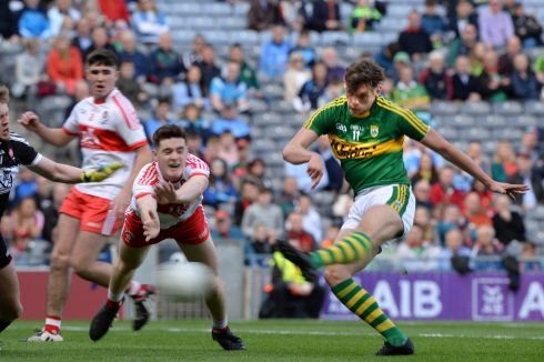 Kerry's David Clifford  scores a goal despite effort of Derry's Pádraig McGrogan. Photograph: Dara Mac Donaill