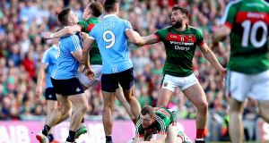 Mayo's Donal Vaughan strikes Dublin's John Small. Both men were sent off in the pivotal moment of the game. Photograph: Ryan Byrne/Inpho
