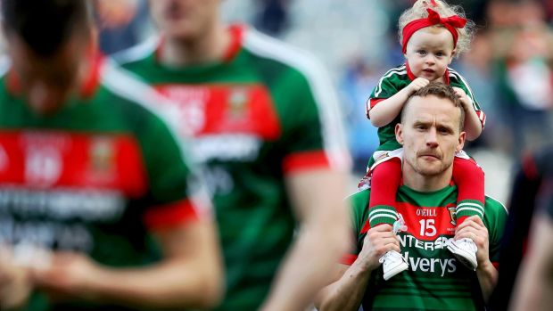 Mayo's Andy Moran with his daughter Charlotte after losing the All-Ireland final by a point. Photograph: Tommy Dickson/Inpho