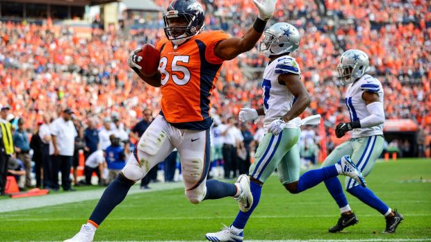 Virgil Green scores for the Denver Broncos during their win over the Dallas Cowboys. Photograph: Dustin Bradford/Getty