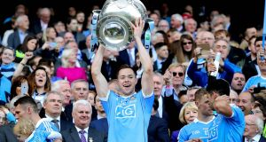 Dublin's Dean Rock lifts the Sam Maguire Photograph:  Ryan Byrne/INPHO