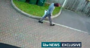 CCTV still issued by ITV News appearing to show a person walking with a Lidl bag on the morning of the Parsons Green terror attack. The footage is reported to have been filmed near a house in Sunbury-on-Thames, Surrey, which is at the centre of one of two police raids. Photograph: ITV News/PA Wire