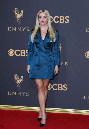 Reese Witherspoon in a tailored blue suit at the 2017 Emmy Awards. Photograph: Mike Blake/Reuters
