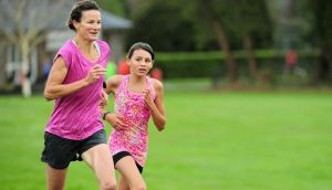 Former Olympian Sonia O'Sullivan with her daughter Sophie at Malahide Castle Parkrun in April 2014. Photograph: Tomas Greally