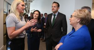 Taoiseach Leo Varadkar and Tánaiste Frances Fitzgerald listen to Lindsay Browning at the opening of LinkedIn's new Europe, Middle East and Africa headquarters in Dublin. Photograph: Niall Carson/PA Wire