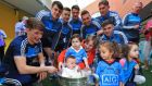 Molly Brown (six months), from Donabate, is pictured in the Sam Maguire alongside members of the Dublin team at Our Lady's Children's Hospital, Crumlin. Photograph: Colin Keegan/Collins Dublin