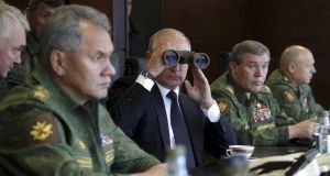 Russian president Vladimir Putin watches the Zapad-2017 war games with minister for defence Sergei Shoigu (left) and chief of the general staff of Russian armed forces Valery Gerasimov (second right) in Leningrad, Russia. Photograph:  Mikhail Klimentyev/Kremlin via Reuters