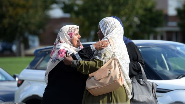 Nosayba Halawa, left, hugs friends as the family celebrate at home in Firhouse. Photograph: Dara Mac Dónaill