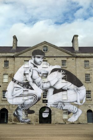 REACHING OUT: Street artist Joe Caslin, has installed the second piece of 'The Volunteers' series on the facade of Collins Barracks, Dublin. This piece features Cormac Coffey, a 20-year-old advocate of volunteering, and Eanna Walsh (28), who in 2014 was diagnosed with bipolar disorder.
