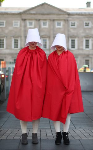 A HANDMAID'S TALE: Protesters dressed as handmaids outside Leinster House, ahead of a 'Handmaids' lobby to mark the first public meeting of the Oireachtas committee on the Eighth Amendment. Photograph: Niall Carson /PA Wire
