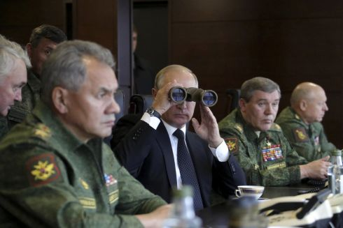 SHOW OF STRENGTH: Russian president Vladimir Putin watches the Zapad-2017 war games, held by Russian and Belarussian servicemen, with defence minister Sergei Shoigu and Russian army chief Valery Gerasimov at a military training ground in the Leningrad region. Photograph: Mikhail Klimentyev/Reuters