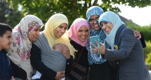 Members of the Halawa family – Nosayba, Omaima (with her baby Abdullah), Khadija, Fatima and Somaia – celebrate at home in Dublin after hearing news of their brother Ibrahim's acquittal in Cairo. Photograph: Dara Mac Dónaill