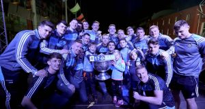 Dublin team celebrate on stage with the Sam Maguire . Photograph: Bryan Keane/Inpho
