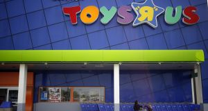A customer exits from a Toys R Us store in Kentucky, US, on Monday, September 18th, 2017. Toys R Us, which has struggled to lift its fortunes since a buyout loaded the retailer with debt more than a decade ago, has filed for bankruptcy. Photograph: Bloomberg