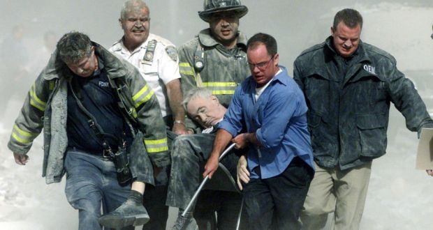 Image result for Rescue workers carry fatally injured New York City Fire Department Chaplain Father Mychal Judge from one of the World Trade Center towers in New York City, early Sept. 11, 2001.