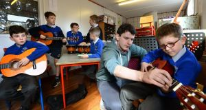Students at St Cronans BNS, Bray, Co Wicklow, taking part in a Music Generation class. From left are     Ultan Moran, Ronan Hogan, Luke Shiel, Christopher Jensen, Alex Coogan, tutor Tim Doyle and Vincent Ducorroy. Photograph: Dara Mac Dónaill/The Irish Times