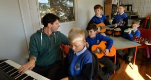 Students at St Cronans Boys' National School, Bray, Co Wicklow, taking part in a Music Generation class. From left: Tutor Tim Doyle, Casey Earls, Ultan Moran, Ronan Hogan, Luke Shiel, Christopher Jensen and Alex Coogan. Photograph: Dara Mac Dónaill/The Irish Times
