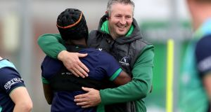 Connacht forwards coach Jimmy Duffy with Niyi Adeolokun at the squad training session at the Sportsground. Photograph: Bryan Keane/Inpho