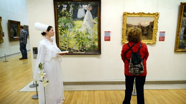 Sinéad O'Brien dressed as 'A Convent Girl' from a painting by William Leech (in background) as part of Paintings Come to Life in 2013. Photograph: Alan Betson