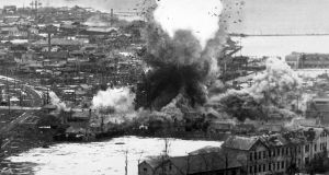 US B-26 Invader light bombers unleash parachute demolition bombs upon supply warehouses and dock facilities at the port city of Wonsan, in southeastern North Korea, in 1951. Photograph:  Interim Archives/Getty Images