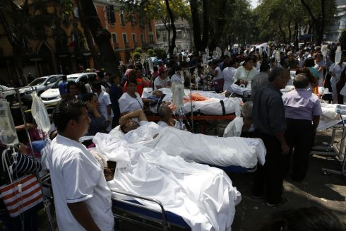 Patients lie on their hospital beds after being evacuated following an earthquake in Mexico City.  Photograph: Rebecca Blackwell / AP