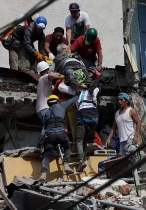 An injured man is pulled out of a building that collapsed during an earthquake in the Roma Norte neighborhood of Mexico City. Photograph: Rebecca Blackwell / AP