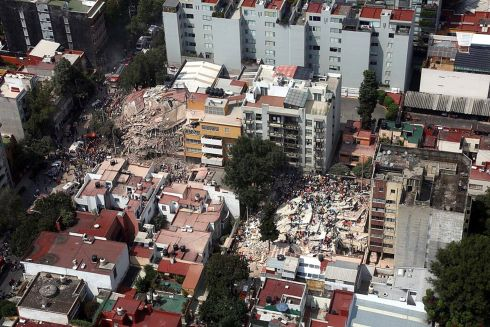 Aerial view shows hundreds of people, including affected and rescuers, during rescue work amidst collapsed buildings following a 7.1 magnitude earthquake, in Mexico City, Mexico.  Photograph:  EPA/STR