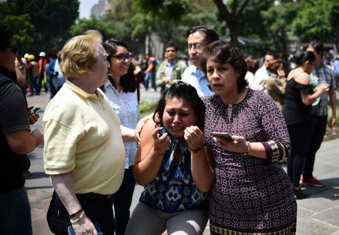 People react as the real 7.1 quake rattles Mexico City on September 19th while an earthquake drill was being held in the capital. Photograph: Ronaldo Schemidt  / AFP