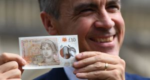 Mark Carney of the Bank of England with the new £10 note featuring Jane Austen. Photograph: Chris J Ratcliffe/Getty