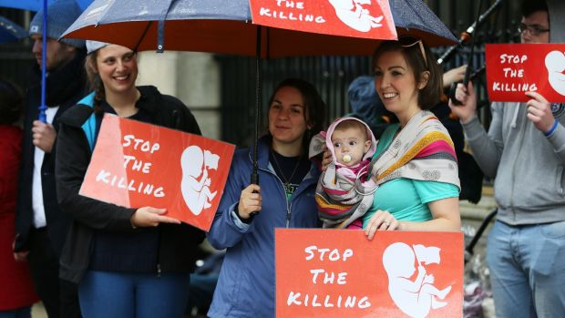 Anti-abortion campaigners outside Leinster House, as the first public meeting of the Dail Committee on the Eighth Amendment opened. Photograph: Brian Lawless/PA Wire