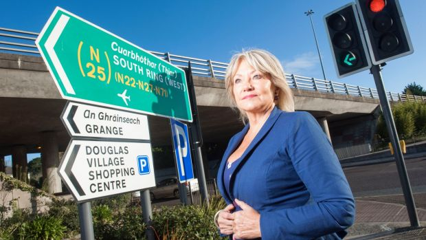 Fine Gael councillor Deirdre Forde at the current boundary line between Cork city and county in Douglas village. Photograph: Provision